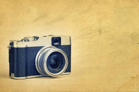Vintage Rangefinder Style Camera on a Textured Background with Space for Text Photographic Print