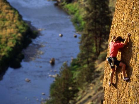 Man Climbing a Rock Wall above the River, Oregon Photographic Print
