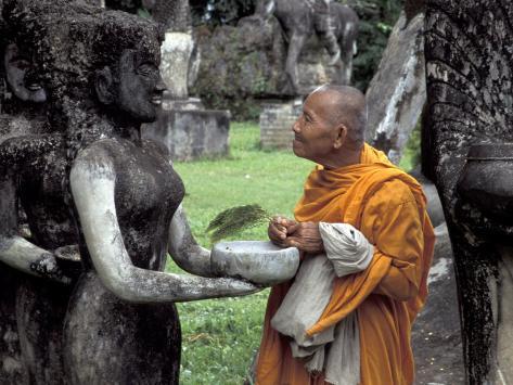 Old Monk Praying at Xieng Khuan (Buddha Park), Laos Photographic Print