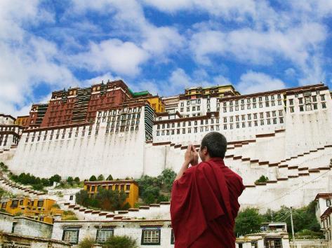 Tibetan Monk with Potala Palace, Lhasa, Tibet, China Photographic Print