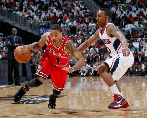 Chicago Bulls v Atlanta Hawks - Game Four, Atlanta, GA - MAY 08: Jeff Teague and Derrick Rose Photo