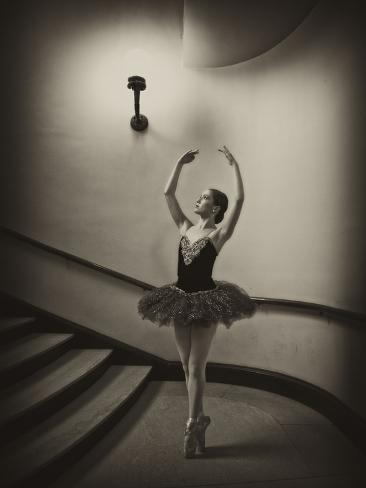 A Ballerina Dancing En Pointe in a Stairwell Photographic Print