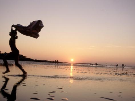 Silhouetted Girl Runs with Beach Towel, MA Photographic Print