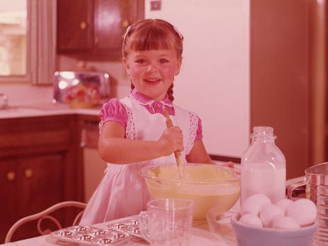 Girl Mixing Batter in a Bowl at Kitchen Table, Circa 1960's Stretched Canvas Print