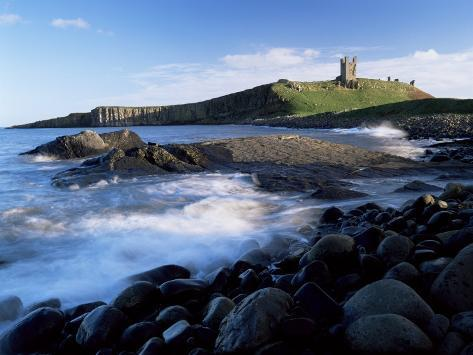 Dunstanburgh Castle, a National Trust Property, from Embleton Bay, Northumberland, England Photographic Print