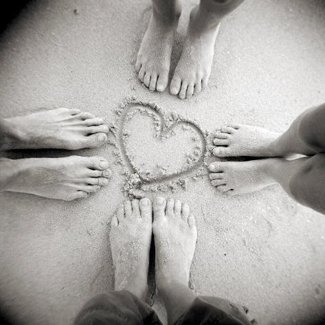 Four Pairs of Feet Standing around a Heart Shape Drawn in Sandy Beach, Taransay, Scotand, UK Photographic Print