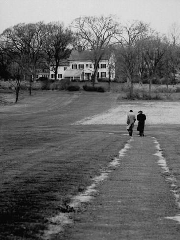Distant of Mathematicians Albert Einstein and Kurt Godel Taking a Walk Premium Photographic Print