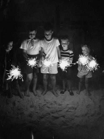 Children Holding Sparklers on a Beach Photographic Print