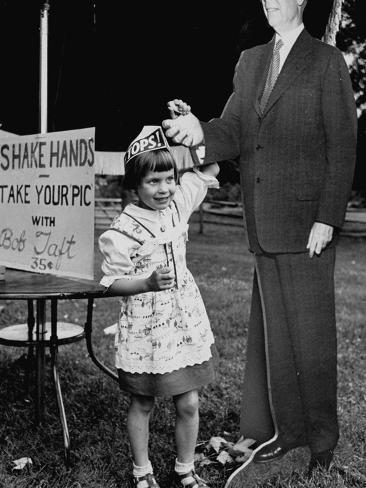 Little Girl Shaking Hands with Cardboard Image of Robert Taft at Carnival to Raise Campaign Funds Stretched Canvas Print