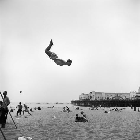 Man Flying Off a Trampoline at Santa Monica Beach Photographic Print