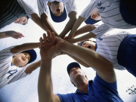 Low Angle View of Children of a Baseball Team in a Huddle Photographic Print