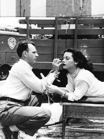 Makeup Artist Ben Nye Applying Eye Makeup to Actress Hedy Lamarr Who Observes in a Mirror Photo