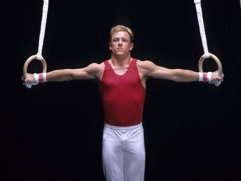 Male Gymnast Performing on the Rings Photographic Print