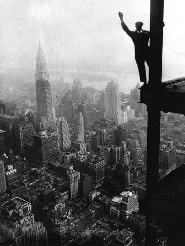 man waving from empire state building construction site photographic