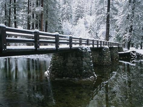 A Snow-Covered Footbridge Spanning the Merced River Photographic Print