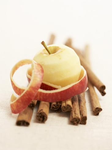 A Peeled Apple on Cinnamon Sticks Photographic Print