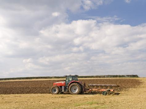 Tractor Ploughing a Field, England Photographic Print