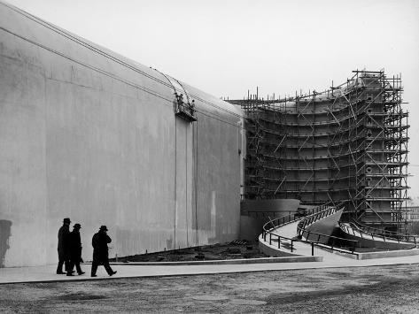 Men Walking Along Grounds before Opening of World's Fair Stretched Canvas Print