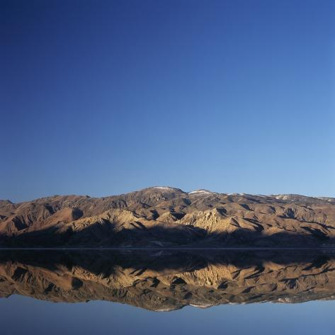 Brown Hills Reflected in a Lake Photographic Print