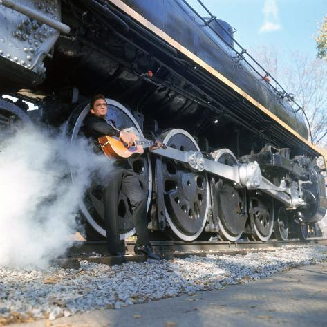 Country/Western Singer Johnny Cash W. Guitar by Wheels of a Steam Train Premium Photographic Print