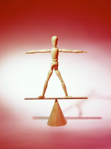 Wooden Figure on Balance Board Photographic Print