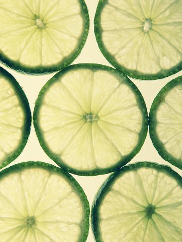 Organic Lime Slices on White Background Valokuvavedos