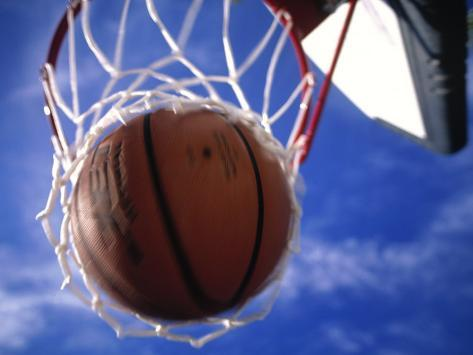 Basketball in Hoop Photographic Print
