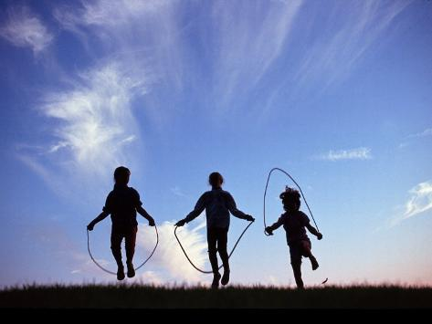 Silhouette of Children Playing Outdoors Photographic Print