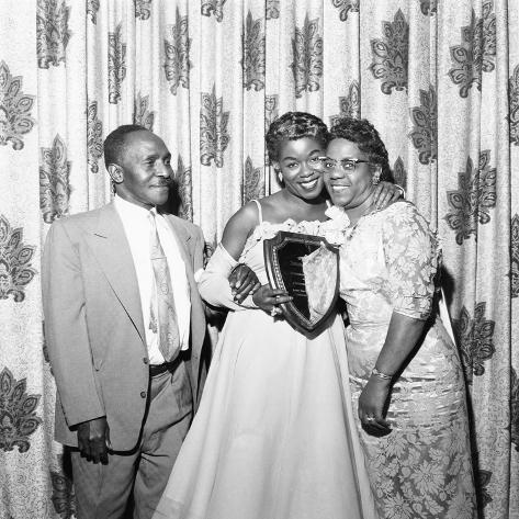 Sarah Vaughan celebrating Sarah Vaughan Day with her parents - 1957 Photographic Print