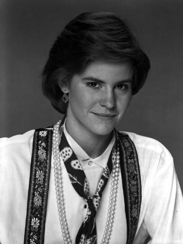 Ally Sheedy Looking at the Camera Showing a Small Smile in Portrait Photo
