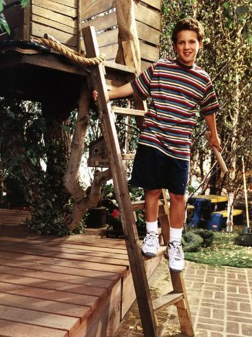 Ben Savage standing on a Wood Ladder in Striped Black T-Shirt and Black Basketball Short with White Photo