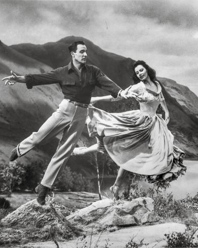 Brigadoon Woman and Man Jump Pose Photo