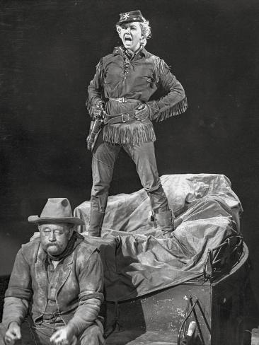 Calamity Jane standing Man and sitting Man in Black and White Photo
