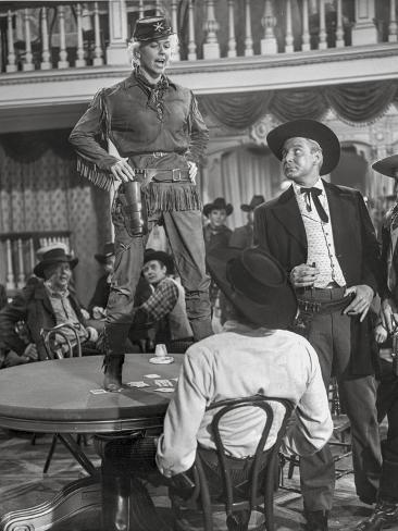 Calamity Jane standing on The Table While Talking in Police Uniform Fotografia