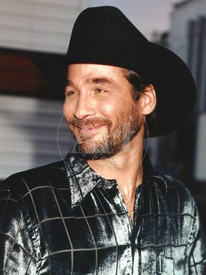 clint black smiling in portrait photo by movie star news at