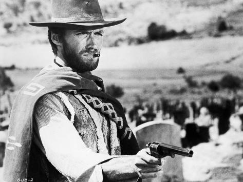 Clint Eastwood Posed in Cowboy Attire with Pistol Photo