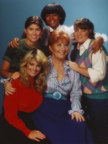 facts of life posed with arms over the shoulders of