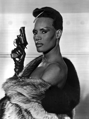Grace Jones Holding Pistol in Classic Photo