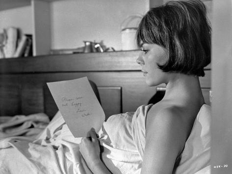 Inside Daisy Clover Woman Reading a Pocket Book on The Bed Photo