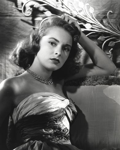 Janet Leigh sitting on the Couch in Strapless Gatherer Bodice Shoulder Dress Photo