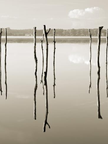"""""""Suspended in the Air"""" – Reflected in Water Remains of the Old Jetty on the Photographic Print"""