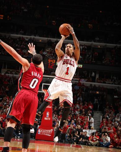 Miami Heat v Chicago Bulls - Game Five, Chicago, IL - MAY 26: Derrick Rose and Mike Bibby Photo