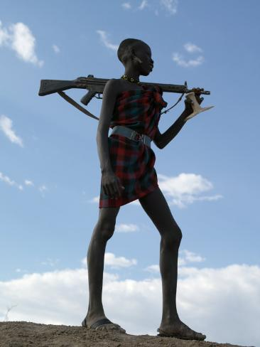 Silhouette of an Armed Nyag'Atom Herdsman on the Banks of the Omo River, Ethiopia Photographic Print