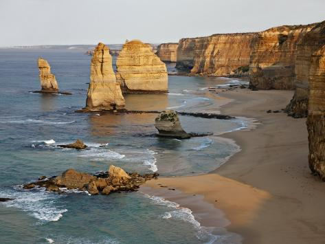 Victoria, Some of Twelve Apostles Standing in Shallow Water, Port Campbell National Park, Australia Photographic Print