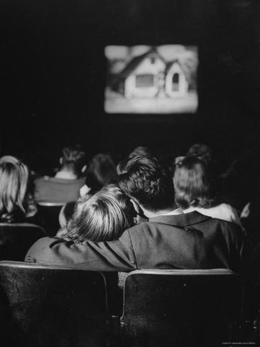 Teenage Couple Necking in a Movie Theater Photographic Print