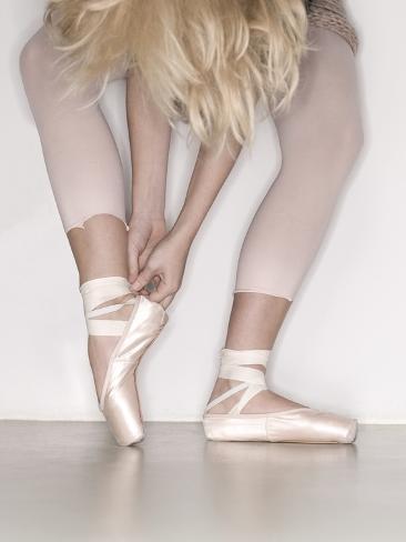 Ballerina adjusting toe shoe Stretched Canvas Print