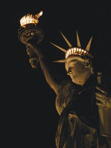 The Statue of Liberty at Night Photographic Print