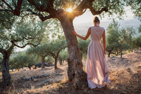 Yong Women in Olive Field Looking toward the Sea on Sunset Photographic Print