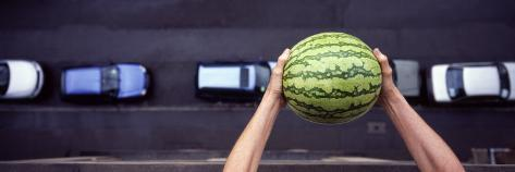 Person Dropping a Watermelon from High Above onto a Street Photographic Print