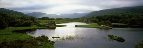 Sunlight on Water, Distant Mountains in Mist, Ireland Photographic Print